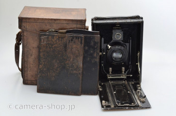 unknown wooden follding camera with STYLOR H.ROUSSEL PARIS 6.3/135